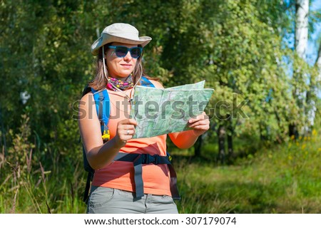 Young woman exploring the trekking map