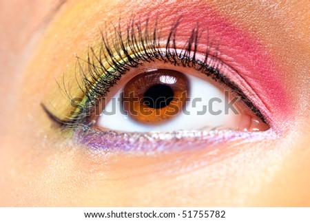 Young woman eye with makeup closeup. Vibrant colors. - stock photo