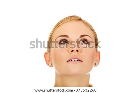 Young woman eyes looking up - stock photo