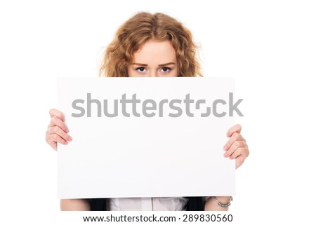 Young woman eyes over a blank promotional display isolated on a white background.