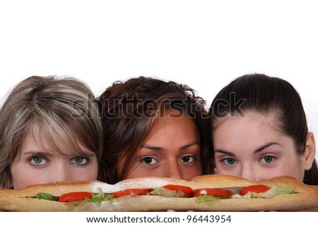 Young woman eying a sandwich - stock photo