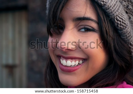 young woman face with a big smile - stock photo