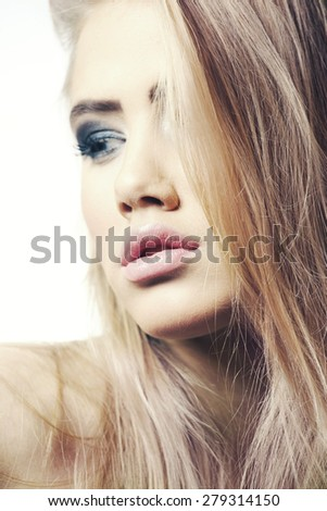 Young woman face with expression - stock photo