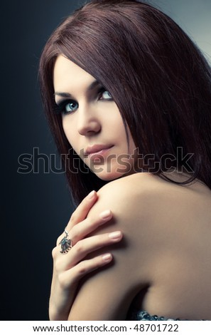 Young woman fashion portrait. Soft yellow and blue tint. - stock photo
