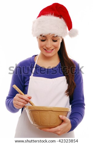 Young woman festive cooking - stock photo