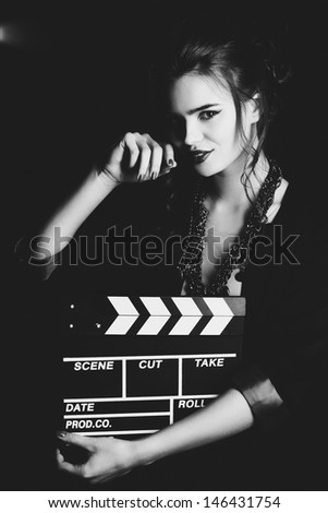 Young woman film director portrait. Film style black and white. - stock photo