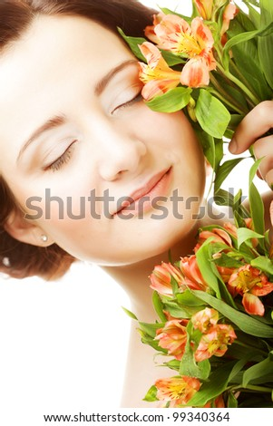 young woman fith bright pink-yellow flowers - stock photo