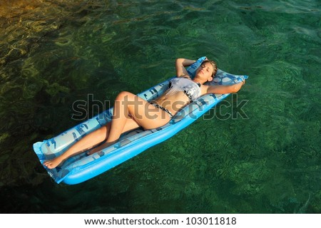 Young woman floating on the sea
