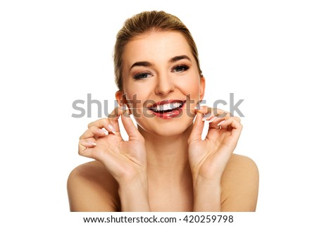 Young woman flossing teeth. - stock photo