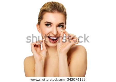 Young woman flossing teeth,isolated on white.