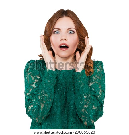 Young woman frighten, delighted, surprised, shocked. Her eyes and mouth wide open. red haired woman in green dress. close-up portrait isolated on white. - stock photo