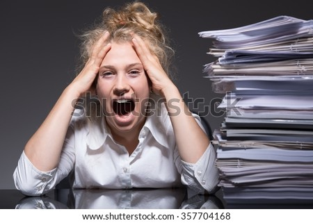 Young woman frustrated and stressed at work - stock photo