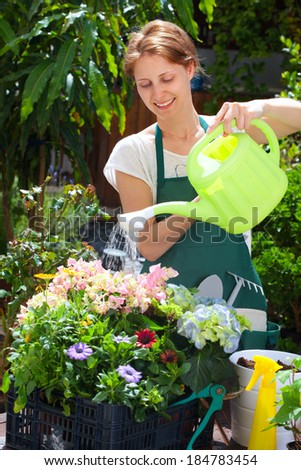 Young woman gardening outdoor - stock photo