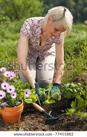 Young woman gardening outdoor close up shoot - stock photo