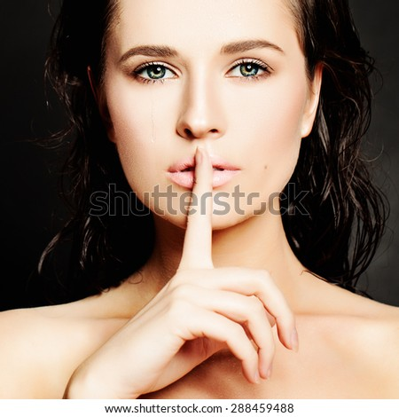 Young Woman Gesturing for Quiet or Shushing. Silence concept - stock photo