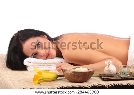Young woman getting a massage in spa, studio