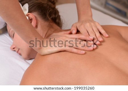 Young woman getting back massage close up