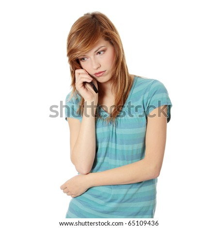 Young woman getting bad news by phone. Isolated on white - stock photo
