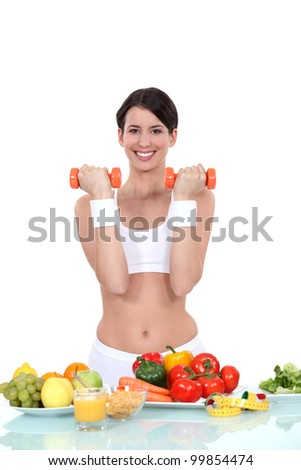 Young woman getting fit - stock photo