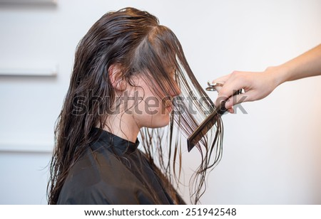 Young woman getting her hair done in a trendy hair salon - stock photo