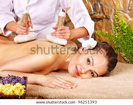 Young woman getting massage in spa.
