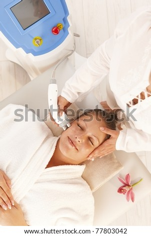 Young woman getting radio frequency cellulite treatment in day spa.? - stock photo