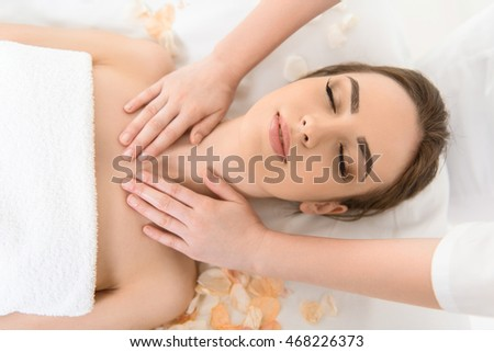 Young woman getting treatment at spa