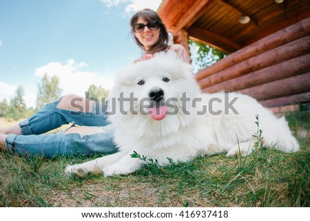 young woman girl  white dog jeans - stock photo