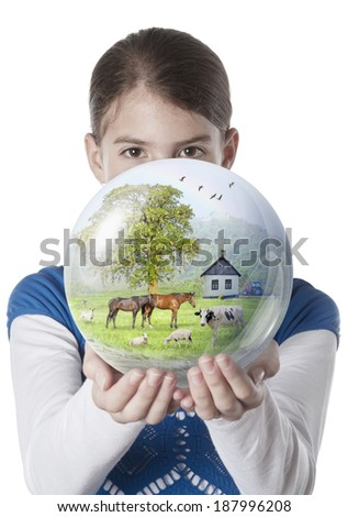 Young woman giving farm globe on isolated white background - stock photo