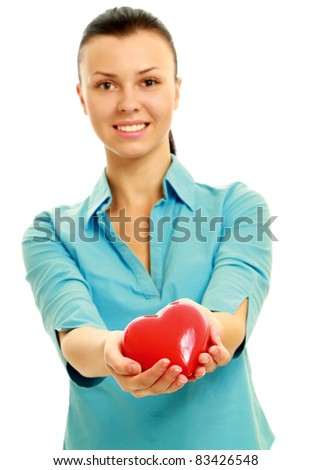 Young woman giving symbol of heart isolated on white background.