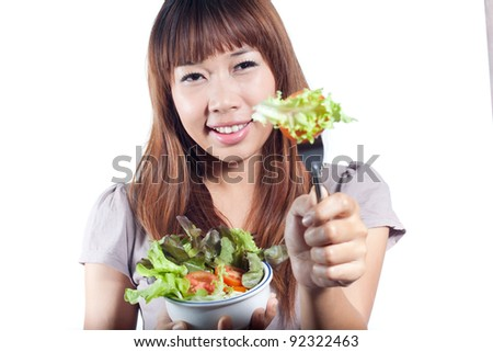 Young woman giving you vegetables salad on fork, healthy eating  concept