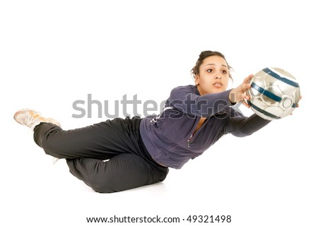 young woman goalkeeper catching ball isolated on white - stock photo