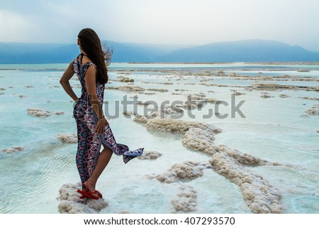 Young woman going to Dead Sea, Israel - stock photo