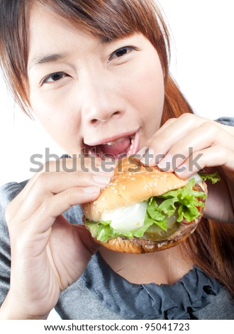 Young woman going to eat burger, shallow  depth of field,  focus at woman's face