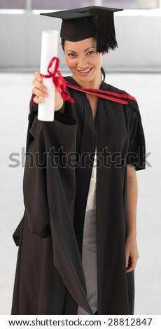 young woman Graduating holding her Diploma at camera - stock photo
