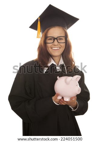 Young woman graduation holding pink piggy bank isolated on white background