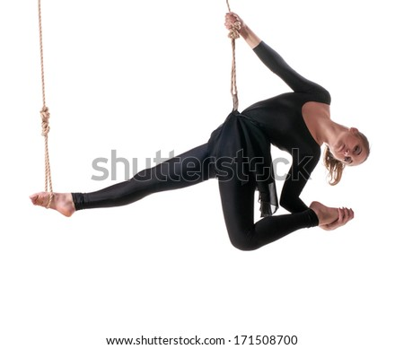 Young woman gymnast on rope on white background