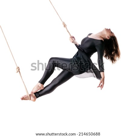 Young woman gymnast on the rope on white background  - stock photo