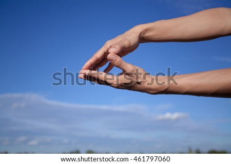 Young woman hand on blue sky white cloud background.