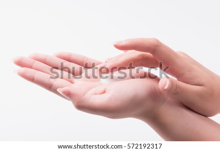 Young woman hand with lotion and cream on white.
