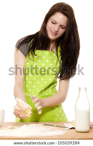 young woman handling dough for baking on white background - stock photo