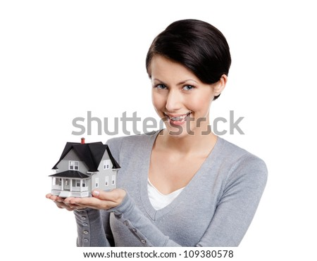 Young woman hands small toy house, isolated on white - stock photo