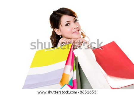 young woman happily shopping full of paper bags