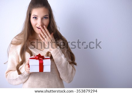 Young woman happy smile hold gift box in hands - stock photo