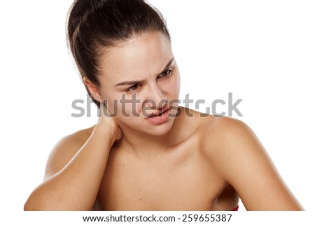 young woman has pain in the neck