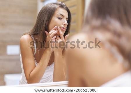 Young woman has problems with skin on the face  - stock photo