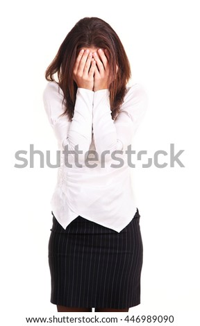 Young woman has shut face with hands, isolated on white background.  - stock photo