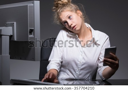 Young woman has too many responsibilities at work - stock photo