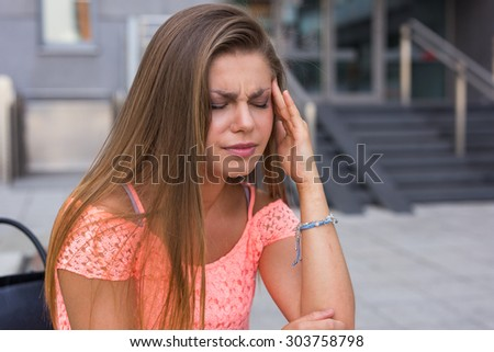 Young woman have a terrible headache. It can be migraine. - stock photo