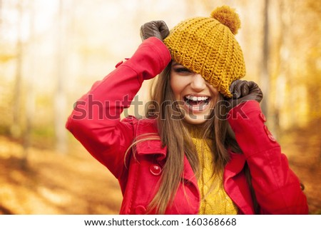 Young woman have fun with autumn clothes  - stock photo